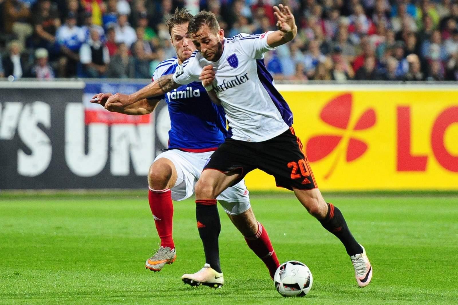 Marc Heider im Zweikampf mit Rafael Czichos. Jetzt auf Osnabrück gegen Holstein Kiel wetten!