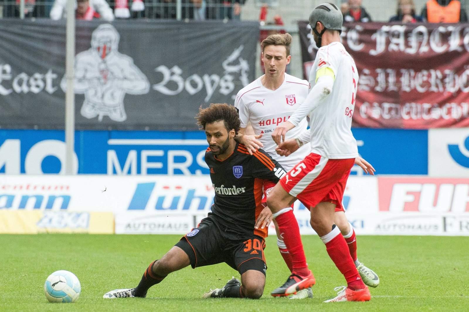 Zweikampf zwischen Nazim Sangaré und Klaus Gjasula. Jetzt auf Osnabrück gegen Halle wetten!