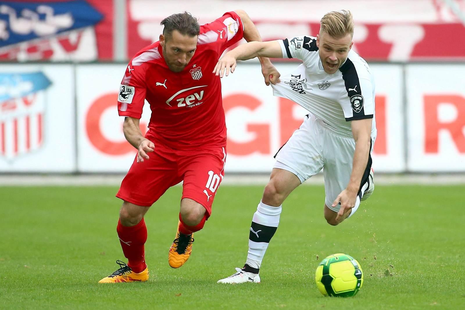 Aykut Öztürk gegen Guillaume Cros. Jetzt auf die Partie Jena gegen Zwickau wetten.