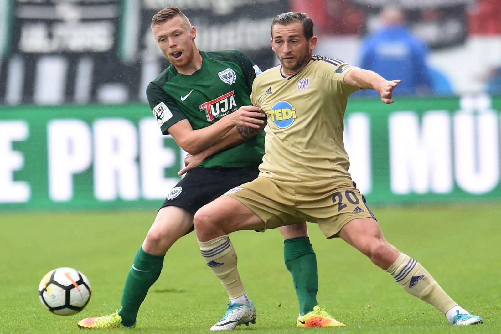 Marc Heider vom VfL Osnabrück gegen Fabian Menig von Preußen Münster
