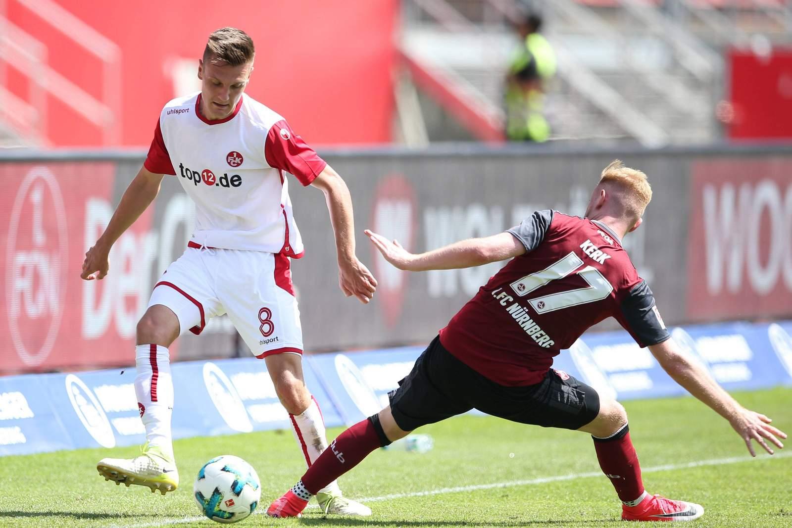 Gino Fechner vom FCK gegen Sebastian Kerk vom 1. FC Nürnberg